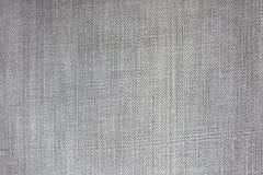 Grauer Farbe Jeans-Beschaffenheitshintergrund Lizenzfreie Stockfotografie