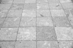 Grauer Fliesenboden Stockfoto
