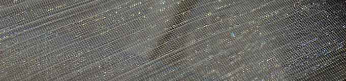 Grauer glänzender Paillettetextilhintergrund Lizenzfreie Stockfotos