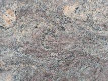 Grauer Granit mit Aderbeschaffenheit Stockfoto