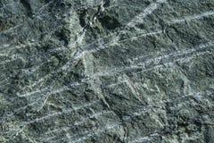 Grauer Granitoberflächenstein mit hellen Linien und Streifen Lizenzfreie Stockfotos