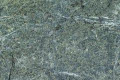 Grauer Granitoberflächenstein mit hellen Linien und Streifen Stockbilder