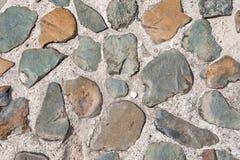 Grauer Hintergrund der Steinwand Stockfoto
