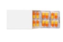 Grauer Kasten mit orange Pillen in einer Blisterpackung Stockbild