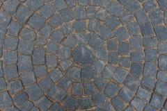 Grauer Pflasterstein gepflastert mit einem Muster Lizenzfreie Stockfotografie