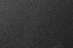 Grauer Plastikhintergrund. Abschluss oben Lizenzfreies Stockbild