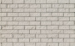 Grauer roguh Backsteinmauerhintergrund Lizenzfreies Stockfoto