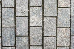 Grauer Stein deckt Beschaffenheitshintergrund mit Ziegeln Stockfotos