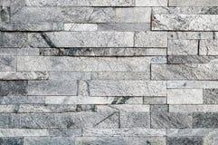 Grauer Steinwandbeschaffenheits- oder -zusammenfassungshintergrund Stockfotografie