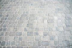 Grauer Ziegelstein auf dem Boden für Straße Lizenzfreie Stockfotos