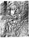 Graues Süßigkeitfolienblatt geknittert getrennt auf Weiß Stockbilder