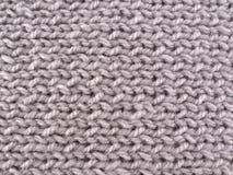 Graues woolen Garn. Hintergrund Lizenzfreie Stockfotografie