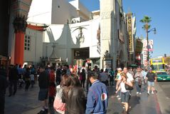 The Grauman's Chinese Theatre in Hollywood. The famous Grauman's Chinese Theatre in Hollywood, California, with tourists flocking to see the sights on the royalty free stock images