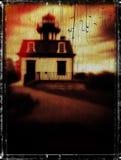 Grausigkeit-Bucheinband-Konzept frequentierter Leuchtturm Stockfotos
