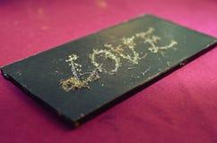 Gravé avec l'amour de mot en chocolat Image stock