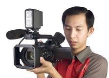 Gravação do homem com câmara de vídeo Fotografia de Stock