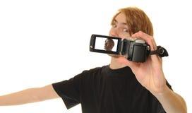 Gravação video ele mesmo do homem que fala Foto de Stock Royalty Free