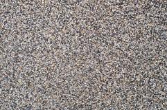 Grava en pared del cemento como fondo. Foto de archivo
