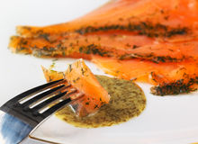 Gravadlax dipped in dill sauce Royalty Free Stock Photo