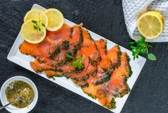 Gravadlax - Nordic dish of thinly sliced raw salmon cured in salt, sugar and dill. And accompanied by dill and mustard sauce - top view stock photos