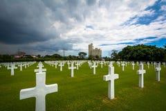 Gravar på Manila den amerikanska kyrkogården & minnesmärken, i Taguig, mig Arkivfoton