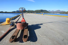 Gravdal's pier with forklift and pipe Royalty Free Stock Photos