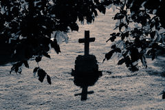 Grave 1. An old cross on a grave in moon light Royalty Free Stock Photography