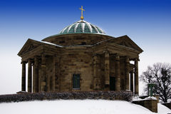 Grave. Chapel in winter with snow Stock Photos