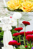 Grave angel. Grave decorations in spring stock photography
