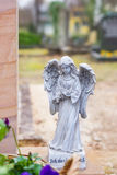 Grave angel on grave stone Stock Images