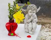 Grave angel in spring Stock Photo