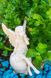 Grave angel in summer planting royalty free stock photo