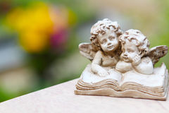 Grave angel. Two Grave angels before blossoms Stock Images