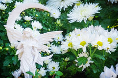 Grave angels in autumn flowers Royalty Free Stock Images