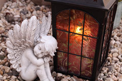Grave angels and lantern Stock Images
