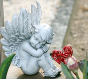 Grave angels. With tulips and heart Stock Photo