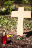 Wooden cross on grave. A grave with a blank wooden cross Stock Image