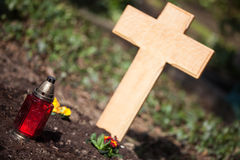 Wooden cross on grave. A grave with a blank wooden cross Royalty Free Stock Photo