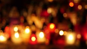 Grave candles on cementery in the night. All Saints Day. Defocus shot stock video footage