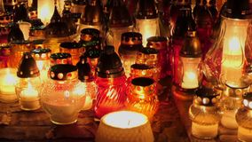 Grave candles on cementery in the night. All Saints Day stock video