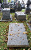 Grave on a cemetery. Grave stone  on the autumn cemetery Royalty Free Stock Image