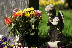 Grave on a cemetery. Graves in a cemetery in spring Stock Images