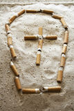 Grave of cigarettes Stock Images