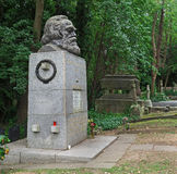 Grave of Communist philosopher Karl Marx. Communist philosopher Karl Marx is buried with a massive monument among the upper middle class bourgeois in Highgate royalty free stock image