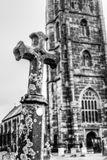 Grave Cross With Blurred Church In Background C Royalty Free Stock Photos