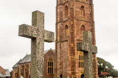 Grave Cross With Blurred Church In Background E Royalty Free Stock Photos