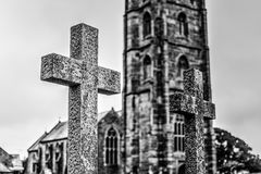 Grave Cross With Blurred Church In Background F Stock Photos