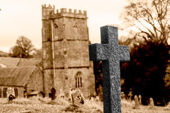 Grave Cross With Blurred Church In Background G Stock Image