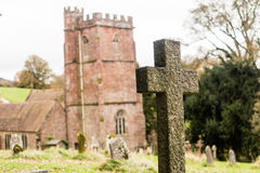 Grave Cross With Blurred Church In Background H Royalty Free Stock Image