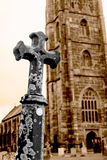 Grave Cross With Blurred Church In Background A Royalty Free Stock Photo
